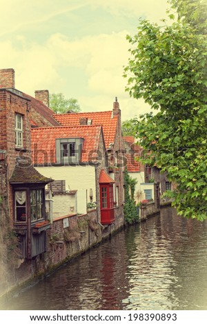 Classic view of channels of Bruges - stock photo