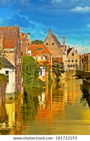 Classic view of channels of Bruges. Belgium - stock photo