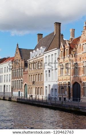 Classic view of channels of Bruges. Belgium. Medieval fairytale city. Summer urban - stock photo