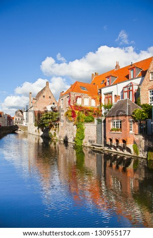 Classic view of channels of Bruges. Belgium. Medieval fairytale city. Summer urban landscape. - stock photo