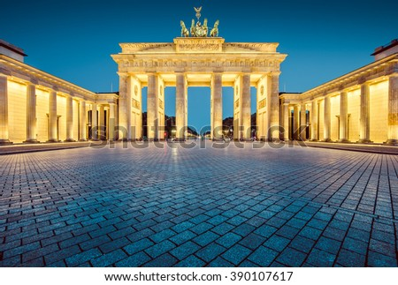 Classic view of famous Brandenburger Tor (Brandenburg Gate), one of the best-known landmarks and national symbols of Germany, in twilight during blue hour at dawn, Berlin, Germany - stock photo