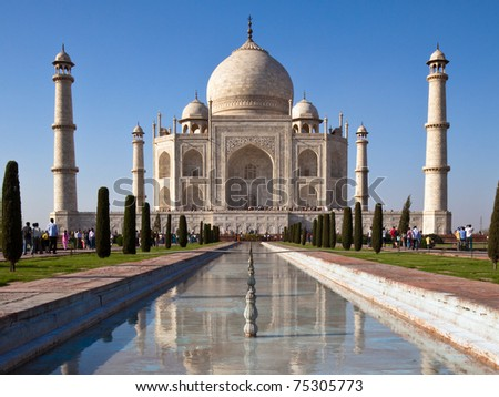 Classic view of Taj Mahal with reflections in a pond in Agra, India. - stock photo