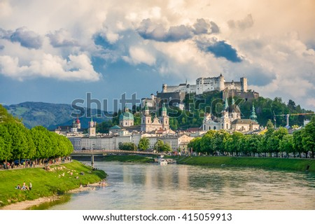 Classic view of the famous historic city of Salzburg with Hohensalzburg Fortress and Salzach river in beautiful golden evening light at sunset with blue sky and clouds, Salzburger Land, Austria - stock photo