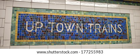 Classic vintage subway directions in Manhattan, New York City. Uptown Trains. - stock photo