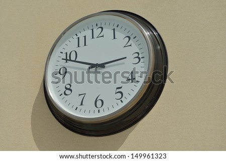classic vintage wall clock on yellow background - stock photo