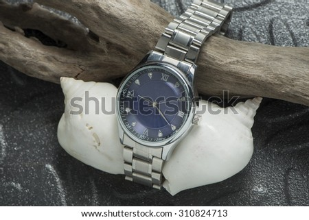 Classic watch on black Steel background - stock photo