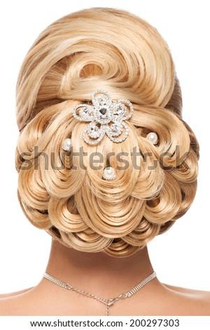 Classic wedding hairstyle. Beautiful bridal hairdo - stock photo