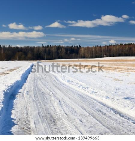 classic winter scene of a road in rural area - stock photo