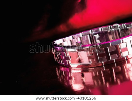 classic woman's watch on a red  background - stock photo