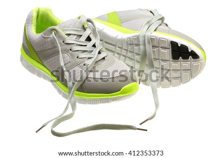 Classic womens sneakers on white background with Clipping Path - stock photo