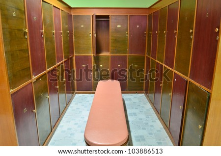 classic wood locker room and a bench - stock photo