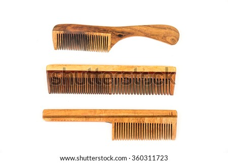 Classic wooden combs of different styles over white background - stock photo