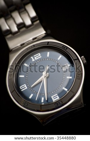 Classic wrist watch on black background - stock photo