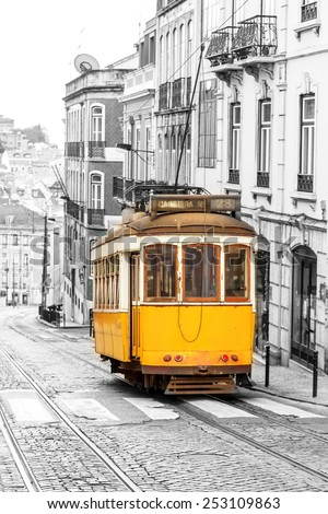 Classic yellow tram on a street in Lisbon, Portugal  - stock photo