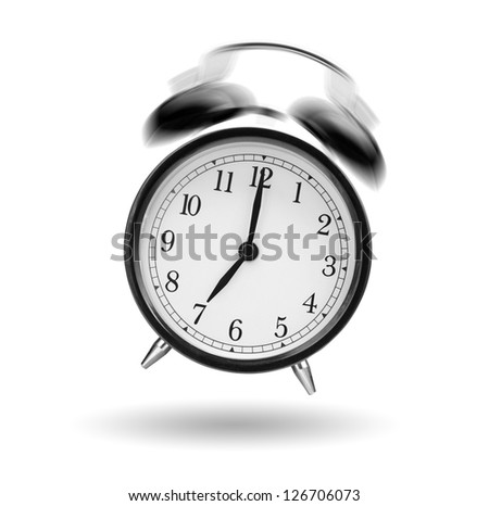 classical alarm clock ringing on white background - stock photo