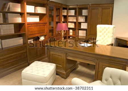 Classical and luxurious office with huge wooden desk and cozy office chair. - stock photo