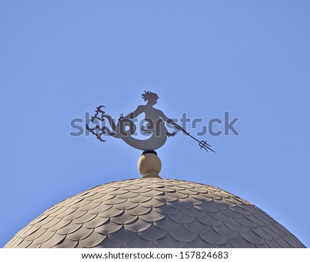 classical building dome detail, with Triton (ancient Greek deity) as wind vane, Athens - stock photo