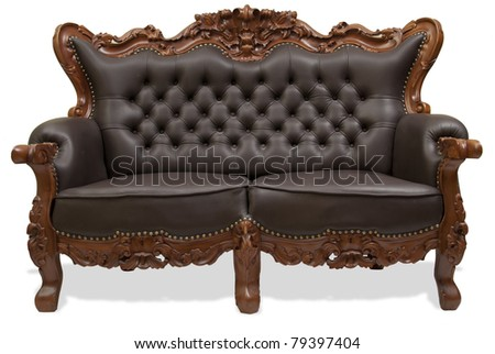 classical carved wooden  sofa upholstered in leather - stock photo