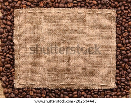Classical frame on coffee beans, with space for your text - stock photo