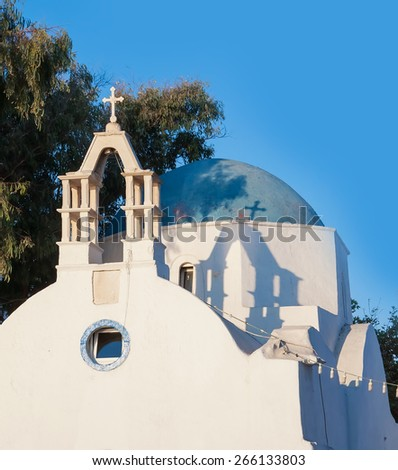 Classical Greek church on the narrow streets of the town of Mykonos. Greece. - stock photo