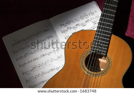 Classical guitar and sheet music still life - stock photo