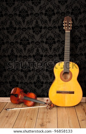 classical guitar and violin in vintage background - stock photo