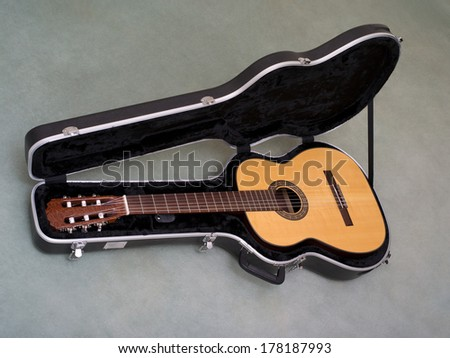 classical guitar in its case - stock photo