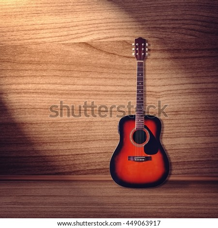 Classical guitar on wood background - stock photo