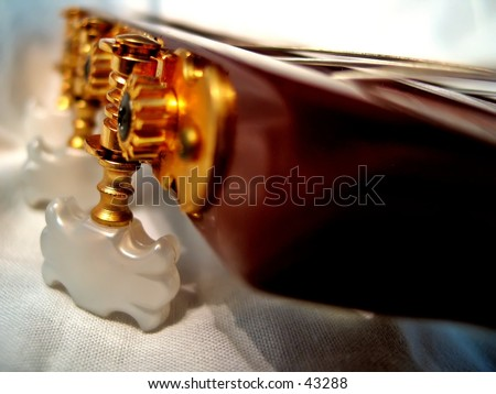 Classical Guitar tuning pegs - stock photo