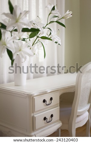 Classical interior with white desk and white lilies  - stock photo