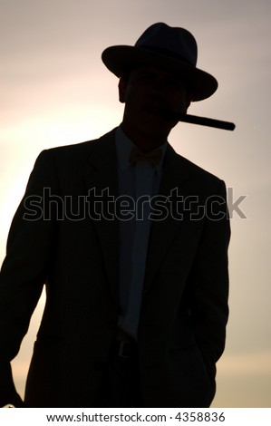 Classical man in a suit silhouette - stock photo