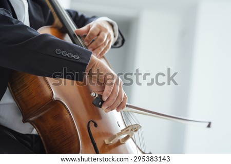 Classical music professional cello player solo performance, hands close up, unrecognizable person - stock photo