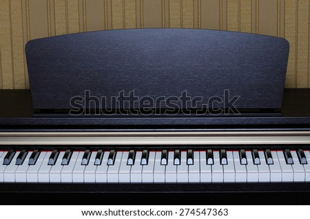 Classical piano keys closeup with open lid - stock photo