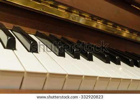 Classical piano keys in warm color tone - stock photo