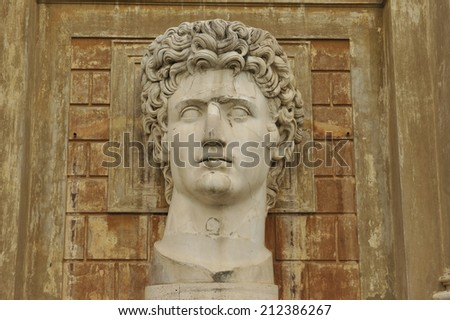 Classical Roman statue of a man with curly hair - stock photo