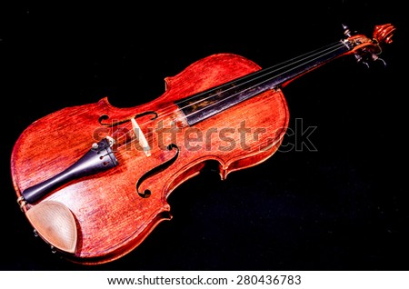 Classical shape wood vintage violin Music instrument isolated on Black background - stock photo