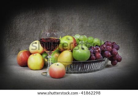 Classical still-life with fruit and a goblet on canvas background - stock photo