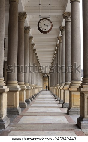 Classical style colonnade with Clock, Karlovy Vary, Czech Republic - stock photo