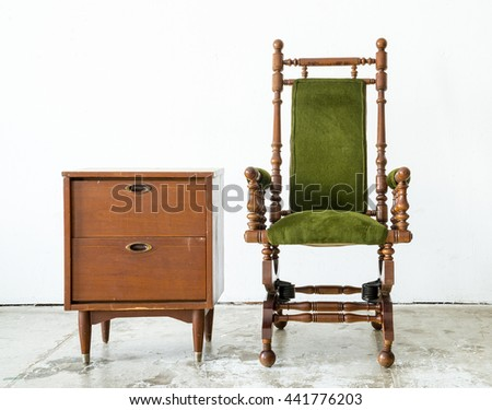 Classical style rocking chair with green wool with old vintage cabinet on white background - stock photo