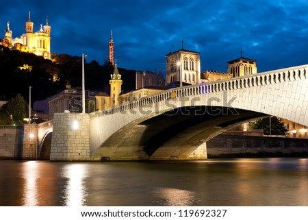 Classical view of Lyon over the Saone river at cloudy night. - stock photo