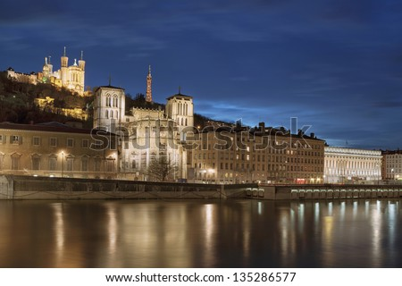 Classical view of Lyon over the Saone river at night - stock photo