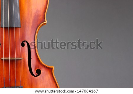 Classical violin on grey background - stock photo