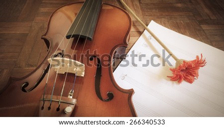 classical Violin & red flower on blank Music sheet for music background - stock photo