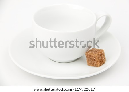 Classical white coffee cup and brown sugar - stock photo