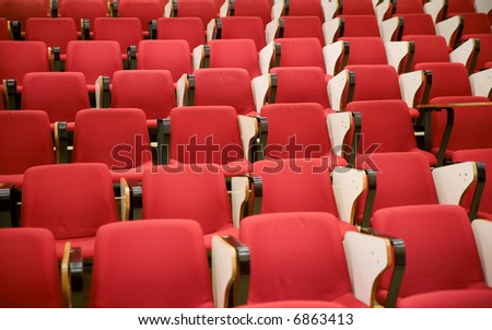 classroom auditorium with red chairs and folding tables - stock photo