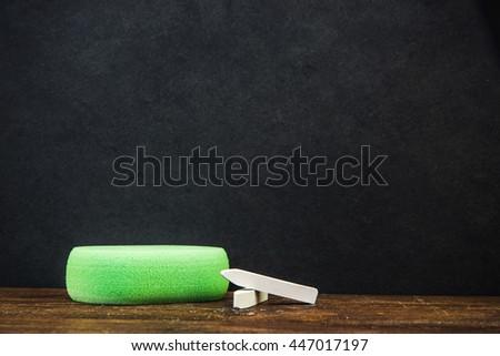 classroom black chalkboard with chalk and sponge eraser - stock photo