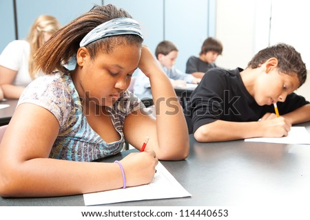 Classroom of diverse students taking objective testing in school. - stock photo