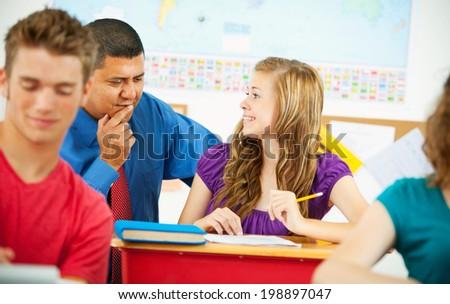 Classroom: Student Gets Class Help From Teacher - stock photo