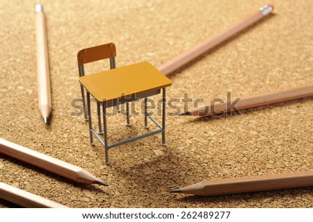 classroom with chairs and desk - stock photo