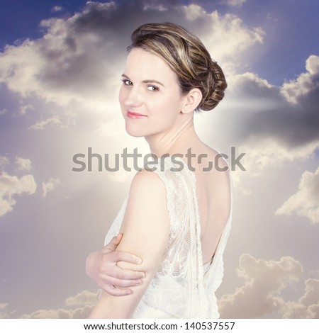 Classy bride enjoying outdoor wedding in old fashion style - stock photo